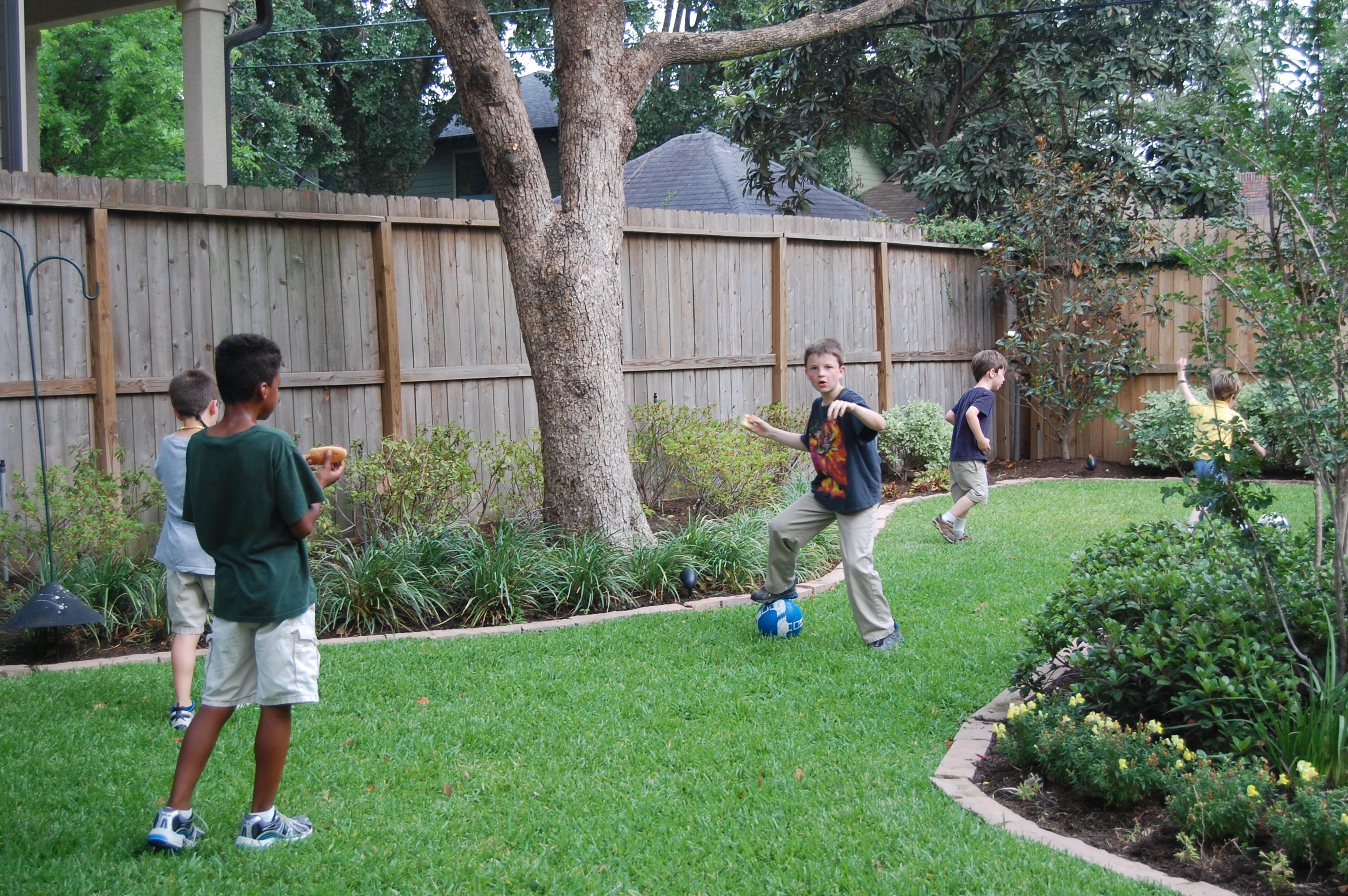 Boys Running Backyard Richwood Place Houston Texas