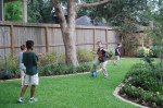 boys running backyard